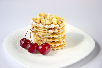 Waffle cookies with banana and cherry.