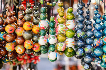 The variety of wooden colorful beads on street market.