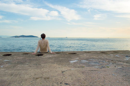 Young Man Sitting by the Sea