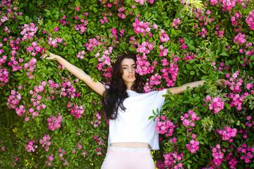 woman near pink rose bush