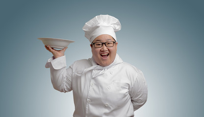 Happy Asian chef with plate in hand