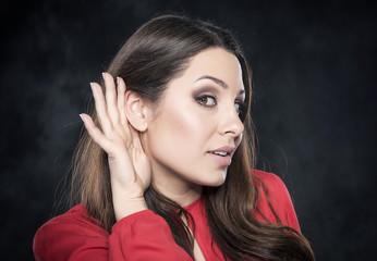 Beautiful young woman listening.