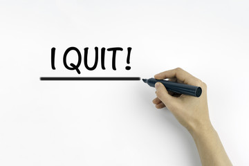 Hand with marker writing: I Quit!