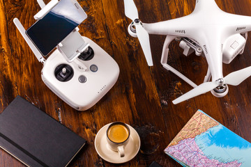 Drone on the old wooden background. Aerial shooting concept. Copter concept of thinking about the objects of flight. Before flight training. Top view. Outfit before the flight.