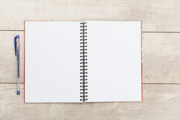 White open notebook on white wood background.