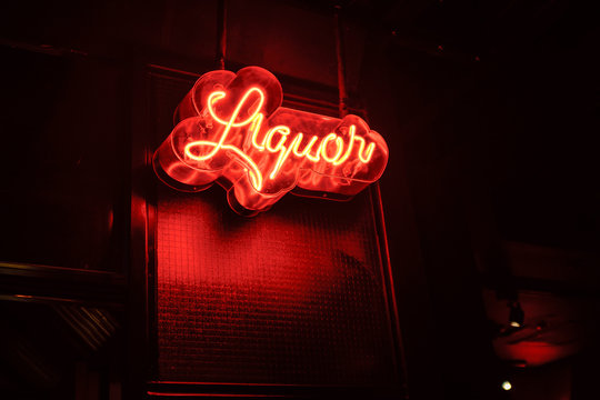 neon liquor sign welcomes customers into the store