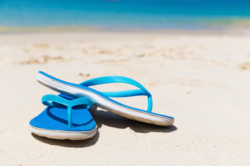 Blue slippers on the beach