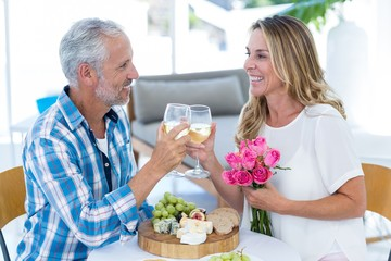 Mature couple toasting wineglass in restaurant
