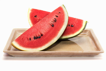 Slices of fresh watermelon in a dish isolated on white background include clipping path Healthy diet fruits concept