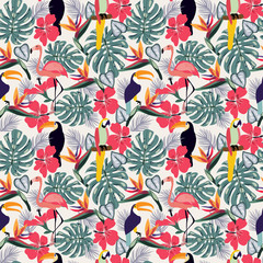 Tropical plants with toucan bird and flowers seamless decorative