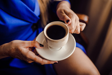Morning coffee. Woman holds a white coffee cup