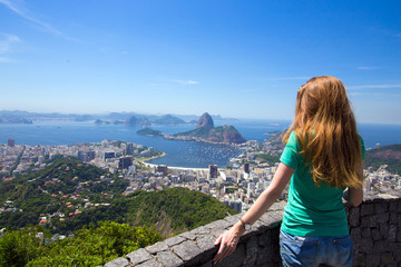 girl tourist looks at Rio landscape