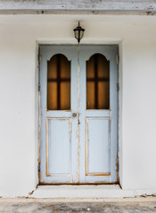 Old wooden door with  White cement wall