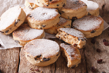 Welsh cuisine: cakes with raisins and powdered sugar close-up. Horizontal