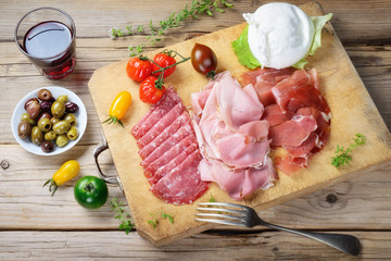 Cold cuts: ham, roast ham, salami with buffalo mozzarella, olives and red wine Chianti