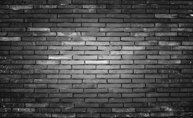 Old and dirty brick wall black background, texture.