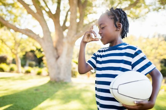 Focus on child holding an object
