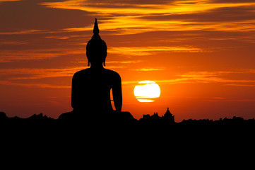 Silhouette public big white Buddha, sunset in Thailand