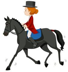 Female jockey on gray horse