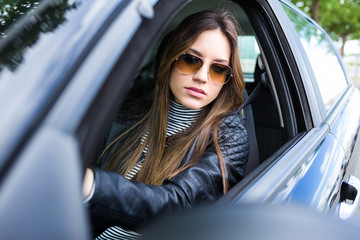 Beautiful young woman driving her car.