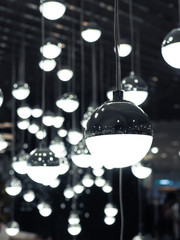 Set of white fluoescent round light bulbs hanging on decorative