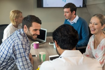 Business people interacting during a meeting