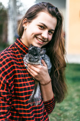 girl playing with her chinchilla