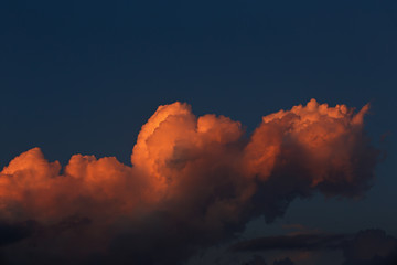 Clouds in the evening sky illuminated by the sun has sat down fo
