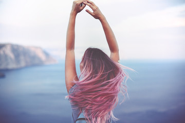 Woman with pink hair over sea