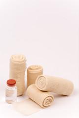 Bandage rolls and injection syringe bottle