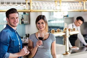 Happy young couple with wineglass