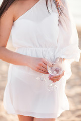 Close up of female hand holding empty clean transparent wine gla