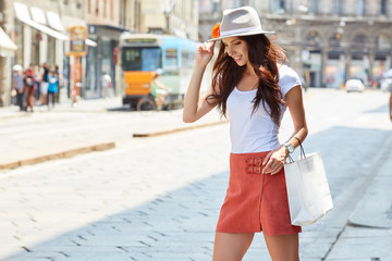 Woman holding shopping bags with the italian colors