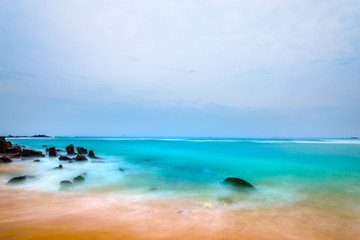 Landscape rocky tropical beach.