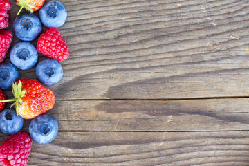 close-up of berries on a wooden background
