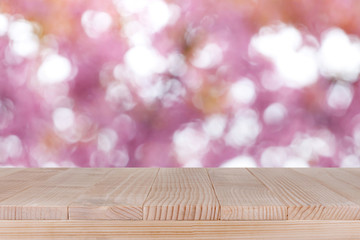 brown wood table top on bokeh abstract pink background - can be