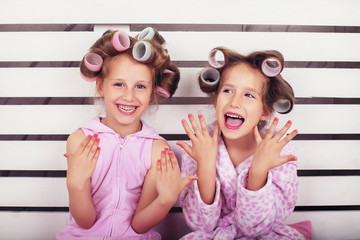 Children laugh and play in a beauty salon