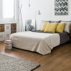 Marital bed in snug bedroom