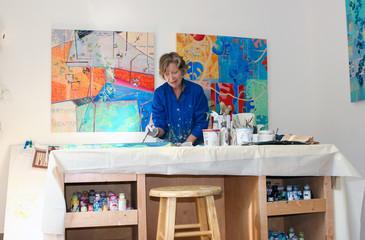 Artist painting canvas