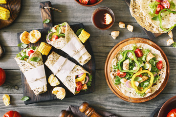 Roll tortilla with grilled chicken fillet and grilled vegetables
