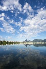 Scenic skyline morning view of Lagoa Rodrigo de Freitas lagoon in Rio de Janeiro, Brazil with Ipanema and Leblon reflecting on the calm horizon