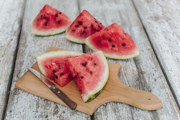 watermelon pieces on the old board