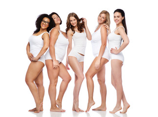 group of happy different women in white underwear