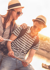 Two young tourists with souvenirs - Sunset, Golden hour, Traveling