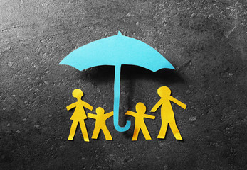Paper family under umbrella