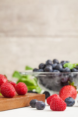 Berries on Wooden Background. Summer or Spring Organic Berry over Wood. Selective focus