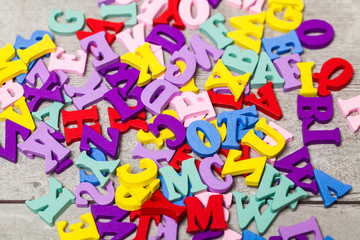 Multi-colored letters on a wooden table. Training. School.