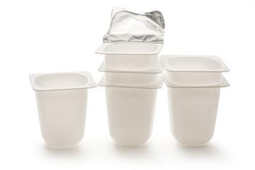 Empty plastic yogurt pots