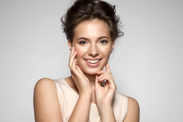 Portrait of a smiling young pretty woman with natural make-up