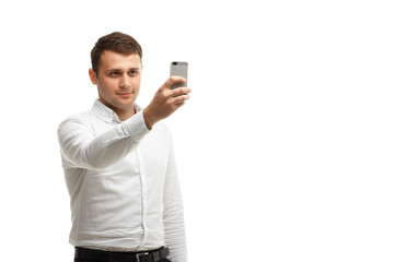 Businessman makes photo using phone